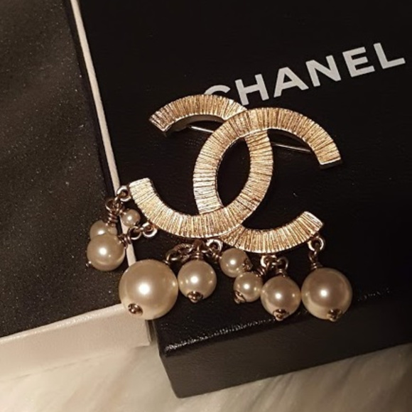 a49eb22441e CHANEL Jewelry - Chanel Gold CC dangling pearls brooch
